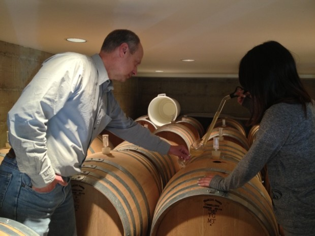 Jr learning how to climb barrels and use a wine thief w Jim Varner